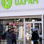 People walked past an Oxfam charity shop in south London.