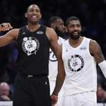 Team Stephen's Al Horford, left, of the Boston Celtics, and Team LeBron's Kyrie Irving, of the Boston Celtics, laugh during the first half of an NBA All-Star basketball game, Sunday, Feb. 18, 2018, in Los Angeles. (AP Photo/Chris Pizzello)
