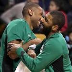Boston MA 12/22/17 Boston Celtics Kyrie Irving and Al Horford on the bench reacting to teammate Terry Rozier's slam dunk against the Chicago Bulls during fourth quarter action at TD Gardenl. (Matthew J. Lee/Globe staff) topic reporter: