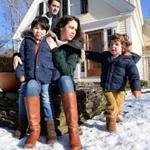 Allicyn Aubut and her husband, Chris, with their children, Miles, 5, and Flecher, 3, in front of their Duxbury home.