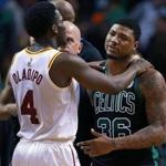 Boston, MA: 3/11/2018: After the final horn sounded, the Celtics Marcus Smart was upset about something, and he jawed with a Pacers opponent, then Indiana's Victor Oladipo (4) came over and tried to calm him down. The Boston Celtics hosted the Indiana Pacers in a regular season NBA basketball game at the TD Garden. (Jim Davis/Globe Staff)