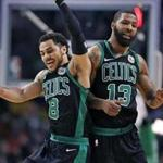 Boston, MA: 3/14/2018: After the Celtics Marcus Morris (13) hit a three point shot that put Boston ahead 103-99, he celebrated with teammate Shane Larkin (8). The Boston Celtics hosted the Washington Wizards in a regular season NBA basketball game at TD Garden. (Jim Davis/Globe Staff)
