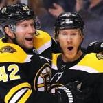 BOSTON, MA - JANUARY 6: Riley Nash #20 of the Boston Bruins celebrates with David Backes #42 after scoring a goal against the Carolina Hurricanes during the first period at TD Garden on January 6, 2018 in Boston, Massachusetts. (Photo by Maddie Meyer/Getty Images)
