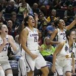 Connecticut's Katie Lou Samuelson (33), Gabby Williams (15), Kia Nurse (11), and Azurá Stevens (23) react on the sideline during the second half of a first-round game against Saint Francis (Pa.) in the NCAA women's college basketball tournament in in Storrs, Conn., Saturday, March 17, 2018. UConn won 140-52. (AP Photo/Jessica Hill)