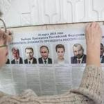 An election worker put up a poster displaying the presidential candidates at a polling station in Crimea on Saturday.