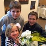 Austin, Hope, and Chase Estabrooks enjoy an arrangement at last year's Duxbury Community Garden Club's show at the Art Complex Museum.