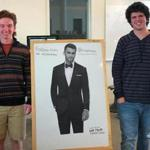 Will Meehan (left) and Spencer Torres stood next to a poster of tux model Clayton Straker.