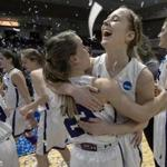 Maeve McNamara and Emma McCarthy of Amherst College celebrated after winning the Division III Women's Basketball Championship in Rochester, Minn., last week.