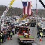 The funeral procession for Daniel Coady wound its way through tow trucks lined up in tribute in North Andover on Wednesday.