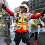 Boston04/16/18 The Boston Marathon finish line. Carlos Arredondo running for his son Alex, who died, crosses the finish line.Photo by John Tlumacki/Globe Staff(sports)