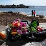 Visitors lay flowers Wednesday at Walker's Point in Kennebunkport in honor of former first lady Barbara Bush, who died Tuesday.