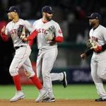 ANAHEIM, CA - APRIL 18: Mookie Betts #50, J.D. Martinez #28 and Jackie Bradley Jr. #19 of the Boston Red Sox celebrate as they run off the field after defeating the Los Angeles Angels of Anaheim 9-0 in a game at Angel Stadium on April 18, 2018 in Anaheim, California. (Photo by Sean M. Haffey/Getty Images)