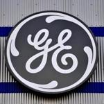 General Electric Co. stuck with its 2018 profit forecast, powering shares to the biggest gain in three years as the beleaguered manufacturer defied expectations of a cut.