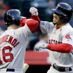 Boston Red Sox's Mookie Betts celebrates his home run with Andrew Benintendi, during the first inning of a baseball game against the Anaheim Angels in Anaheim, Calif., Thursday, April 19, 2018. (AP Photo/Chris Carlson)