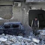 A man viewed the destruction near the site of this month's alleged chemical weapons attack in the town of Douma, Syria.