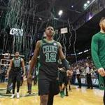 Milwaukee, WI: 4-22-18: As Milwaukee's Jabari Parker and Thon Maker celebrate in the backround far left, the streamers celebrating the Bucks victory start to fall from the rafters, At the same time the Celtics Terry Rozier III (12) and teammate Aron Baynes (right) head off the courrt following their 104-102 loss that tied the series at 2-2. The Boston Celtics visited the Milwaukee Bucks for Game Four of their NBA Eastern Conference first round playoff series at the Bradley Center. (Jim Davis/Globe Staff)