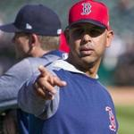 Boston Red Sox manager Alex Cora watches batting practice before a baseball game against the Oakland Athletics in Oakland, Saturday, April 21, 2018. (AP Photo/John Hefti)