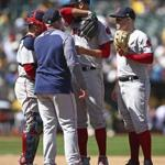 Boston Red Sox pitcher David Price wipes his face as he is visited on the mound by pitching coach Dana LeVangie during the eighth inning of a baseball game against the Oakland Athletics Sunday, April 22, 2018, in Oakland, Calif. (AP Photo/Ben Margot)
