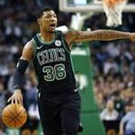 Boston Celtics' Marcus Smart signals during the first quarter of an NBA basketball game against the Indiana Pacers in Boston, Sunday, March 11, 2018. (AP Photo/Michael Dwyer)