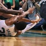 Boston, MA: 4-24-18: The Celticsw Marcus Smart, after winning a loose ball battle makes a nice pass from the floor to teammate Al Horford, who took the ball and scored on a drive to give Boston a 86-79 lead. The Boston Celtics hosted the Milwaukee Bucks for Game Five of their NBA Eastern Conference first round playoff series at the TD Garden. (Jim Davis/Globe Staff)