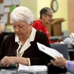 Pat Jackman and others work on getting the Abington Council on Aging's Senior Informer out to its faithful readers.