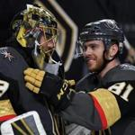 LAS VEGAS, NV - MAY 04: Marc-Andre Fleury #29 and Jonathan Marchessault #81 of the Vegas Golden Knights celebrate after beating the San Jose Sharks 5-3 in Game Five of the Western Conference Second Round during 2018 NHL Stanley Cup Playoffs at T-Mobile Arena on May 4, 2018 in Las Vegas, Nevada. (Photo by Ethan Miller/Getty Images)