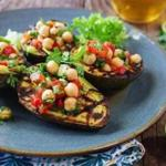 Grilled avocados topped with chickpea salad