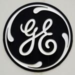 (FILES)This file photo shows the GE logo on a sign outside the corporate headquarters of the General Electric company, in Fairfield, Connecticut. General Electric reported lower second-quarter earnings on July 21, 2017 following a mixed performance of its industrial division as outgoing chief executive Jeff Immelt prepares to step down.Net income was $1.2 billion, down 57 percent from the year-ago period. Revenues fell 11.8 percent to $29.6 billion. The results in the 2016 period were boosted by the inclusion of appliances assets that have since been sold. / AFP PHOTO / STAN HONDASTAN HONDA/AFP/Getty Images
