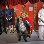 "At Dreamland Wax Museum, Delores Steinlilber took a seat and let ""Queen Elizabeth"" stand."