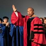 Former governor Deval Patrick gestured Saturday during Bentley University's commencement.