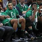 Cleveland, OH: 5-19-18: The expressions on the bench in the fourth quarter of the Celtics (left to right) Marcus Morris, Jayson Tatum, Jaylen Brown and Marcus Smart tell the story of Boston's 116-86 loss. The Boston Celtics visited the Cleveland Cavaliers for Game Three of their NBA Eastern Conference Finals playoff series at the Quicken Loans Arena. (Jim Davis/Globe Staff)