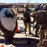 In this February 2016 photo, members of the 790th Missile Security Forces Squadron demonstrate their training for recapturing a Minuteman missile silo after being taken over by an intruder/attacker, just days before the Air Force announced the drug investigation, at the Francis E. Warren Air Force Base, near Cheyenne, Wyo. Then Deputy Secretary of Defense Robert Work, observed the demonstration. Inside an Air Force unit entrusted to protect nuclear missiles, a drug ring operated undetected for nearly a year. Documents obtained by The Associated Press reveal at least six airmen were buying, distributing or using the illegal hallucinogen, LSD. (AP Photo/Robert Burns)