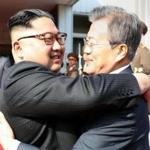 North Korea's leader Kim Jong Un (left) and his South Korean counterpart, Moon Jae-in, hugged in this image handed out by Seoul government officials Saturday after the leaders' second summit.