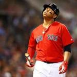 BOSTON, MA - JUNE 08: Rafael Devers #11 of the Boston Red Sox reacts after striking out in the seventh inning of a game against the Chicago White Sox at Fenway Park on June 08, 2018 in Boston, Massachusetts. (Photo by Adam Glanzman/Getty Images)