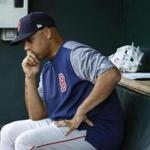 Boston Red Sox manager Alex Cora sits in the dugout before a baseball game against the Baltimore Orioles, Tuesday, June 12, 2018, in Baltimore. (AP Photo/Patrick Semansky)