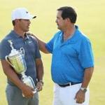 SOUTHAMPTON, NY - JUNE 17: Brooks Koepka of the United States and his father Robert Koepka celebrate with the U.S. Open Championship trophy after winning the 2018 U.S. Open at Shinnecock Hills Golf Club on June 17, 2018 in Southampton, New York. (Photo by Warren Little/Getty Images)
