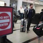Travelers arriving at the international terminal of O'Hare International Airport in Chicago on April 25, the day the Supreme Court began hearing arguments to determine if President Trump's limited travel ban overstepped his power because it singles out several mostly Muslim nations.