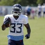 Tennessee Titans running back Dion Lewis runs the ball during NFL football training camp Sunday, July 29, 2018, in Nashville, Tenn. (AP Photo/Mark Humphrey)