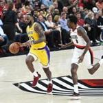 PORTLAND, OR - OCTOBER 18: LeBron James #23 of the Los Angeles Lakers controls the ball against Al-Farouq Aminu #8 of the Portland Trail Blazers in the second quarter of their game at Moda Center on October 18, 2018 in Portland, Oregon. NOTE TO USER: User expressly acknowledges and agrees that, by downloading and or using this photograph, User is consenting to the terms and conditions of the Getty Images License Agreement. (Photo by Steve Dykes/Getty Images)