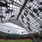 As a part of the Spartan Race over the weekend, participants scaled a ropes obstacle in the outfield of Fenway Park.
