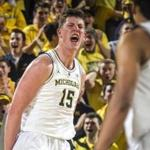 Michigan center Jon Teske (15) celebrates his basket in the first half of an NCAA college basketball game against Purdue at Crisler Center in Ann Arbor, Mich., Saturday, Dec. 1, 2018. (AP Photo/Tony Ding)