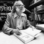 Author Isaac Asimov autographs books at the Mysterious Book Store stall on February 2, 1984 during the Fifth Avenue Book Fair held in New York City, United States. The 64-year-old science fiction writer will publish his 300th book in 1984. (AP Photo/Mario Suriani)