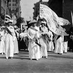 1915: From left to right, Mrs James Leeds Laidlaw, Mrs Albert Plimpton, Mrs A Hughston, Mrs Frank Stratton and Helen Rich lead the Manhattan Delegation on a Woman Suffrage Party parade through New York. (Photo by Paul Thompson/Topical Press Agency/Getty Images)