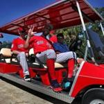 Fort Myers , FL - 2/16/2019 - (Day 5) (HOLD FOR STORY BY PETE ABRAHAM) Boston Red Sox pitcher David Price waves a pitchers board a golf cart that will take them back to the clubhouse. Boston Red Sox pitchers and catchers workout at Jet Blue Park in Fort Myers, FL. - (Barry Chin/Globe Staff), Section: Sports, Reporter: Peter Abraham, Topic: 17Red Sox, LOID: 8.5.416616478.