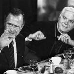 President George H. W. Bush and Cardinal Bernard F. Law sit at a table during a luncheon for the Catholic Lawyers Guild at the Park Plaza Hotel in Boston on Sept. 23, 1989.
