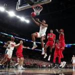 MINNEAPOLIS, MINNESOTA - APRIL 08: De'Andre Hunter #12 of the Virginia Cavaliers attempts a shot against the Texas Tech Red Raiders in the first half during the 2019 NCAA men's Final Four National Championship game at U.S. Bank Stadium on April 08, 2019 in Minneapolis, Minnesota. (Photo by TP_Remote/2019 Getty Images)