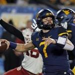MORGANTOWN, WV - NOVEMBER 23: Will Grier #7 of the West Virginia Mountaineers passes against the Oklahoma Sooners on November 23, 2018 at Mountaineer Field in Morgantown, West Virginia. (Photo by Justin K. Aller/Getty Images)