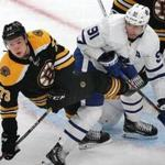Boston-04/11/2019 Boston Bruins vs Toronto Maple Leafs- Bruins Charlie McAvoy battles with Leafs John Tavares in front of the Bruins net in the 2nd period. Photo by John Tlumacki/Globe Staff(sports)