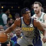 Indiana Pacers' Myles Turner looks to get around Boston Celtics' Gordon Hayward during the second quarter of an NBA basketball game Friday, March 29, 2019, in Boston. (AP Photo/Winslow Townson)