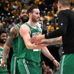 Indiannapolis, IN - 4/21/2019 - (4th quarter) Boston Celtics guard Kyrie Irving (11), Boston Celtics forward Marcus Morris (13), and Boston Celtics forward Gordon Hayward (20) are greeted by Boston Celtics forward Daniel Theis as they head off court after a time out was called following a Hayward jumper that put the Celtics up 102-92 with 1:04 left in the fourth quarter. The Indiana Pacers host the Boston Celtics in Game 4 of Round 1 of the Eastern Conference Playoffs at Bankers Life Field House. - (Barry Chin/Globe Staff), Section: Sports, Reporter: Adam Himmelsbach, Topic: 22Celtics-Pacers, LOID: 8.5.1054786590.